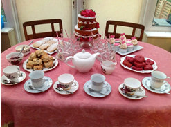 Traditional Cakes and Tea on a Dessert Table