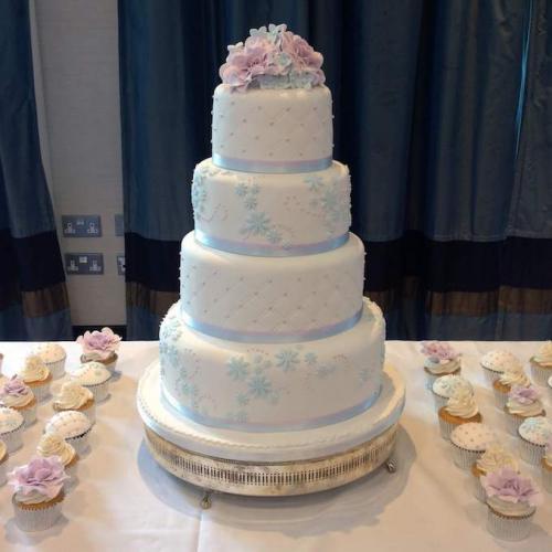 Four Tier Wedding Cake and Cupcakes